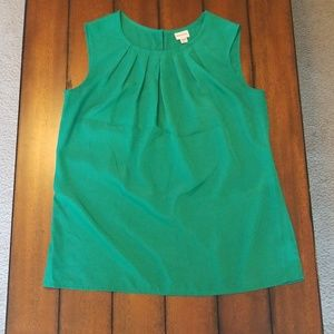 Green sleeveless blouse